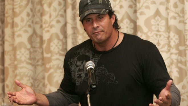 Former baseball player Jose Canseco, shown here during a news conference in 2009, shared his thoughts on gravity with the Internet.
