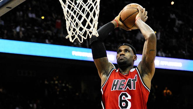 Heat forward LeBron James dunks against the Hawks during Wednesday's 103-90 win.