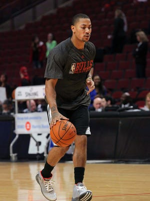 Chicago Bulls point guard Derrick Rose (1) warms up prior to a game against the Miami Heat at the United Center.