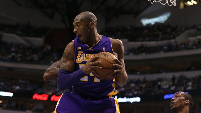 Lakers guard Kobe Bryant grabs a rebound during Sunday's 103-99 win against the Mavericks.