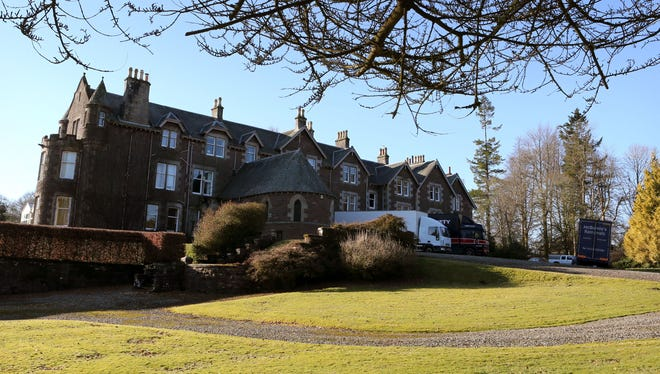 Removal vans are parked at Cromlix House Hotel after tennis ace Andy Murray bought the £1.8 million pound (US dlrs 2.7 million) luxury hotel near his hometown, in Kinbuck, Scotland, Monday Feb. 25, 2013.