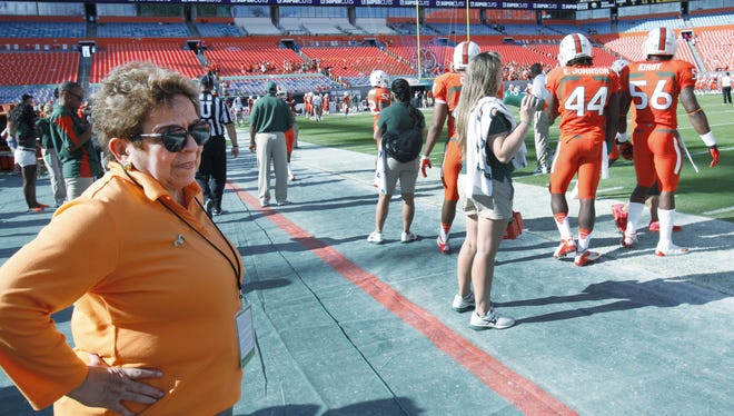 University of Miami president Donna Shalala watches players during warmups before the start of a game against South Florida on Nov. 17.