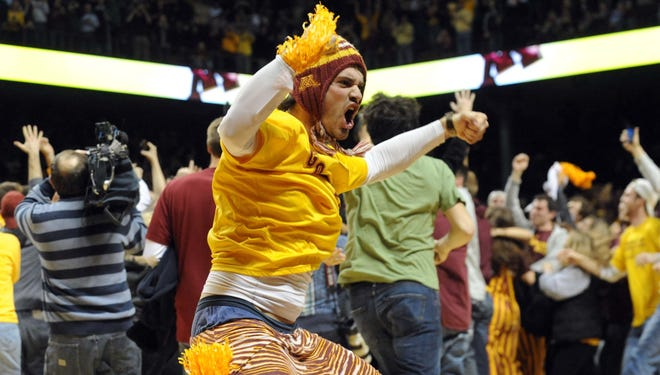 Minnesota fan Everett Scott celebrates the Gophers win over the Indiana Hoosiers at Williams Arena on Feb. 26.