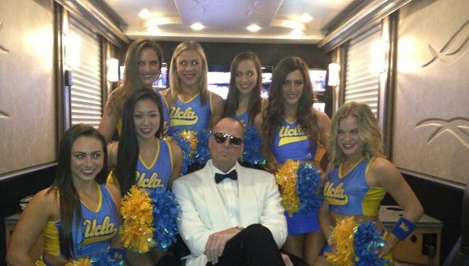 Jay Bilas with UCLA cheerleaders.