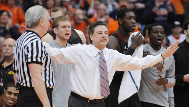 Louisville Cardinals coach Rick Pitino reacts to a call during the second half of a game against the Syracuse Orange at the Carrier Dome. Louisville won the game 58-53.
