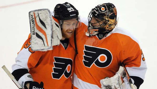 Philadelphia Flyers goalie Ilya Bryzgalov celebrates Wednesday's win with Jakub Voracek.