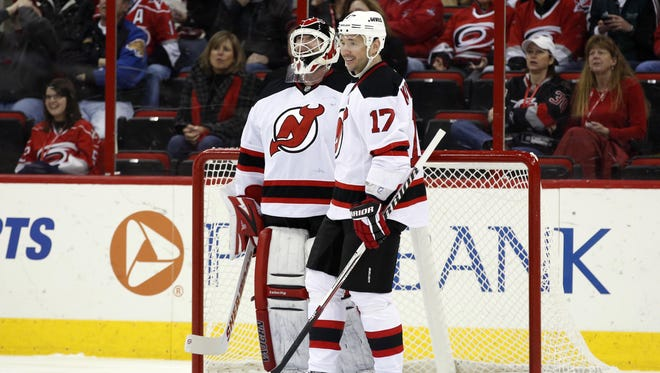 New Jersey Devils goalie Martin Brodeur is congratulated by teammate Ilya Kovalchuk after being credited with a first-period goal.