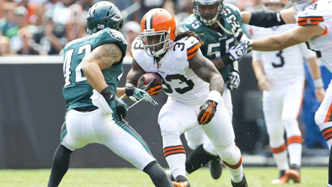 This is Browns running back Trent Richardson, just before he knocked off Kurt Coleman's helmet by running him over during Week 1 last season.