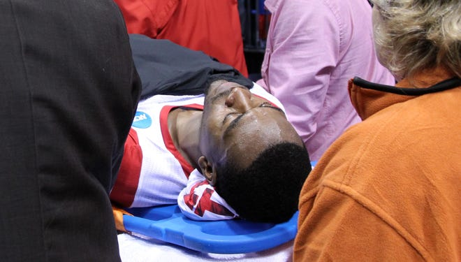 Louisville Cardinals guard Kevin Ware is taken off the court on a stretcher after suffering an injury in the first half against the Duke Blue Devils at Lucas Oil Stadium.