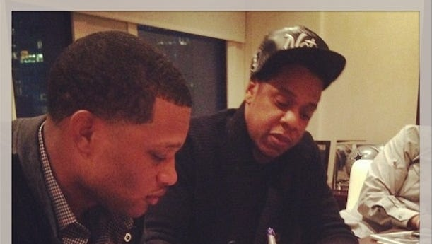 Jay-Z and Robinson Cano sign their contract making the Yankees star the first athlete to sign with Roc Nation Sports.