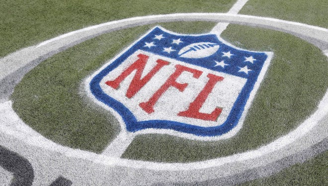A general view of the NFL shield logo on the field.