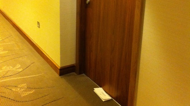 An invoice left outside the door of the Hilton hotel at Heathrow terminal.