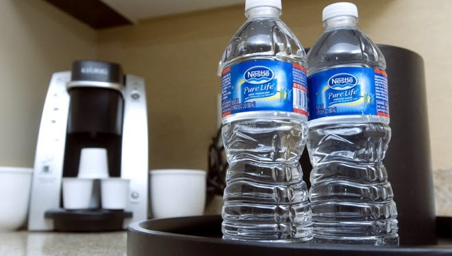 File photo shows bottled water and a coffee maker in a suite at the Best Western Plus Hawthorne Terrace Hotel in the Lakeview neighborhood in Chicago.