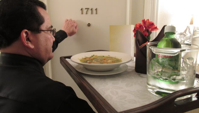 Chicken soup, extra tissues - Hotels' take on flu epidemic: Some hotels are preparing chicken soup to serve to sick guests stuck in their rooms, while others are stocking up on jugs of hand sanitizer gel and boxes of tissues. Employee Jose Rodriguez delivers chicken soup to an under-the-weather guest at the Omni Mandalay Hotel at Las Colinas, Texas.