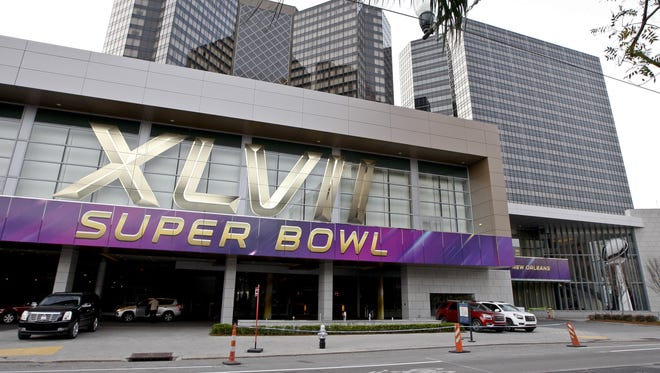 A banner at the New Orleans Hyatt Regency  heralds the Feb. 3 Super Bowl. The good times have been rolling for New Orleans lodgings.