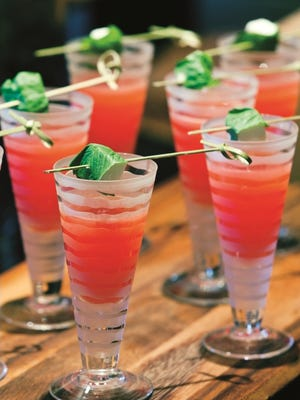Fresh, cold gazpacho shooter served with a lime skewer at The Ritz-Carlton, Dallas. It is one of the healthier items on the banquet menu.