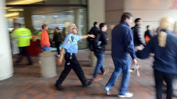 Boston A Security Guard Ushers People Away From The Windows Of Hotel On Huntington Avenue Near Finish Line After Two S Exploded During