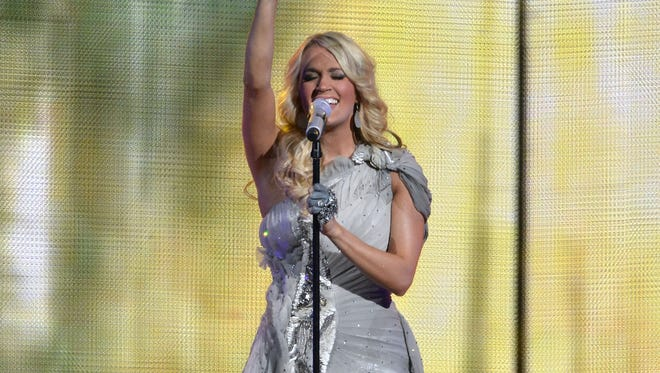 Carrie Underwood, shown here in concert at Nashville's Bridgestone Arena, will star in a live production of 'The Sound of Music' on NBC in 2013.