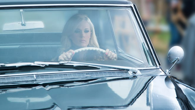 """Carrie Underwood displays her love for Stephen King in the video for her current single, """"Two Black Cadillacs."""""""