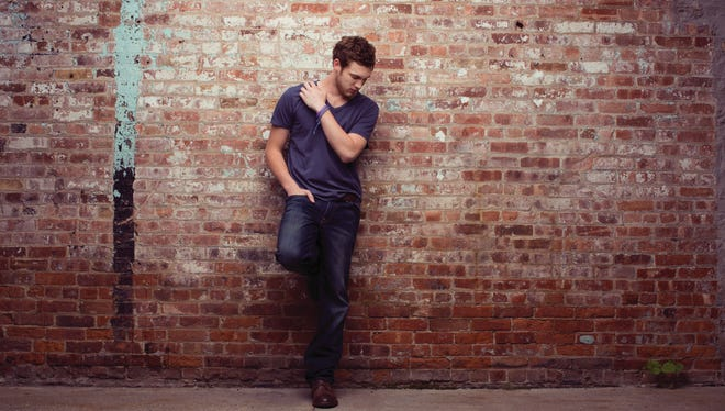 """""""American Idol"""" Season 11 winner Phillip Phillips is at No. 16 on The Billboard 200 chart this week with his """"The World From the Side of the Moon"""" album."""