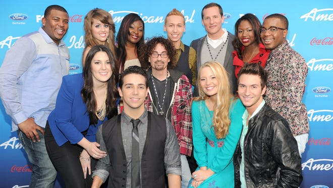 AMERICAN IDOL: (Top Row L-R) The Top Ten finalists Curtis Finch, Jr., Angie Miller, Candice Glover, Devin Velez, FOX Cheif Operating Officer Joe Earley, Amber Holcomb and Burnell Taylor, (Bottom Row L-R) Kree Harrison, Lazaro Arbos, FOX President of Alternative Programming Mike Darnell, Janelle Arthur and Paul Jolley at the season 12 AMERICAN IDOL FINALIST PARTY on Thursday, March 7 at The Grove in Los Angeles, CA.