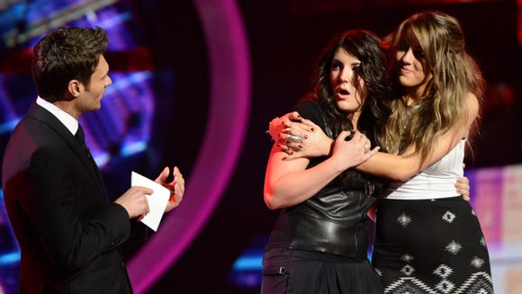 Kree Harrison (L) advances to the finals on AMERICAN IDOL, while Angie Miller is eliminated.