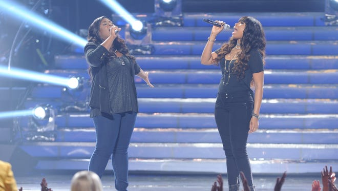 Candice Glover and special guest Jennifer Hudson during the  season 12 American Idol Grand finale at the Nokia Theatre.