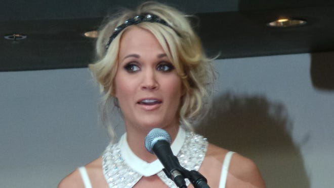 Carrie Underwood welcomes colleagues to a preview of Carrie Underwood: The Blown Away Tour exhibit at the Country Music Hall of Fame and Museum in Nashville.