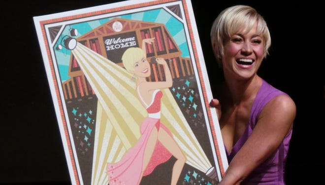 """'Dancing With the Stars' winner Kellie Pickler receives a """"Welcome Home"""" print at the Grand Ole Opry."""