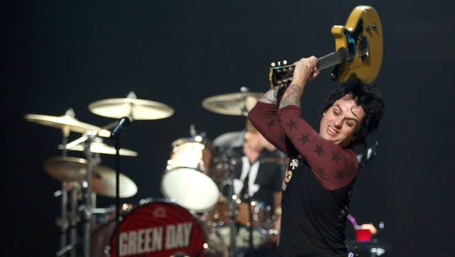 Frontman Billie Joe Armstrong of Green Day smashes his guitar onstage at the 2012 iHeartRadio Music Festival at the MGM Grand Garden Arena on Friday in Las Vegas.
