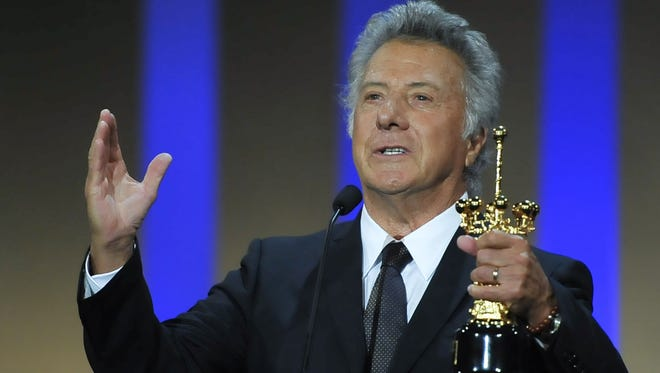 Dustin Hoffman celebrates after receiving the Special Donostia Award at the 60th San Sebastian Film Festival Saturday.