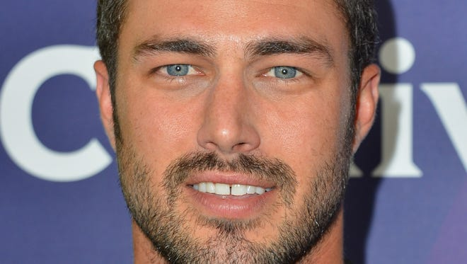 """Taylor Kinney says his buff physique is due mostly to """"genetics."""""""