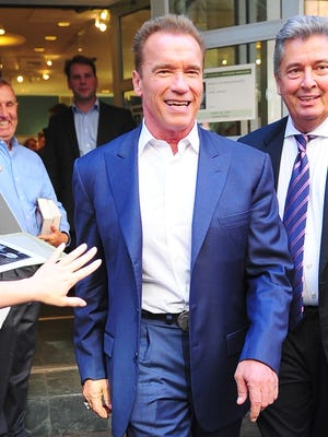 Arnold Schwarzenegger smiles on the streets of NYC on Monday.