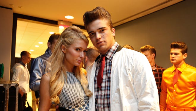 Paris Hilton and model River Viiperi attend the Marlon Gobel Spring 2013 fashion show at the New York Public Library on Sept. 8.