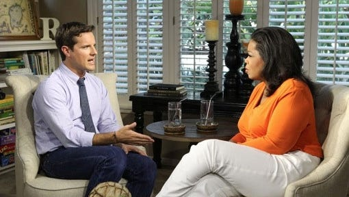 Oprah Winfrey with Jason Russell, creator of 'Kony 2012' in Carlsbad, Calif.