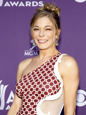 LeAnn Rimes, shown in April, says she has been having a 'dental nightmare' for 10 months.