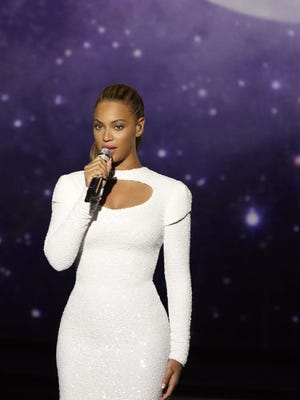 In this photo provided by Parkwood Entertainment, singer Beyonce performs ìI Was Hereî in the United Nations General Assembly Hall on Aug. 10.