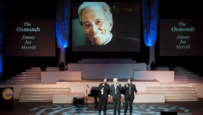 Jay Osmond, left, Merrill Osmond and Jimmy Osmond sing at Andy Williams' memorial service at the Moon River Theater in Branson, Mo., on Sunday.