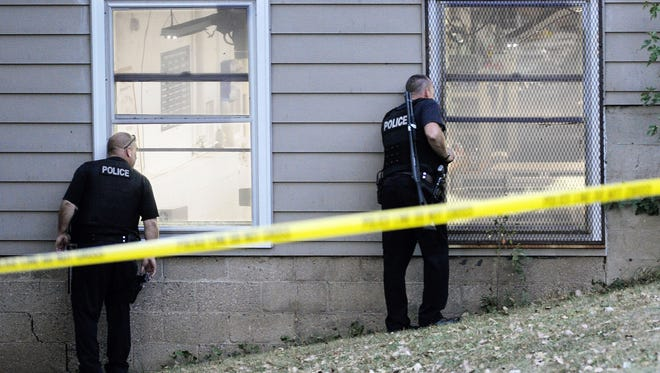 Police in Minneapolis investigate the scene of a shooting at Accent Signage Systems, which left five people dead, including the gunman.
