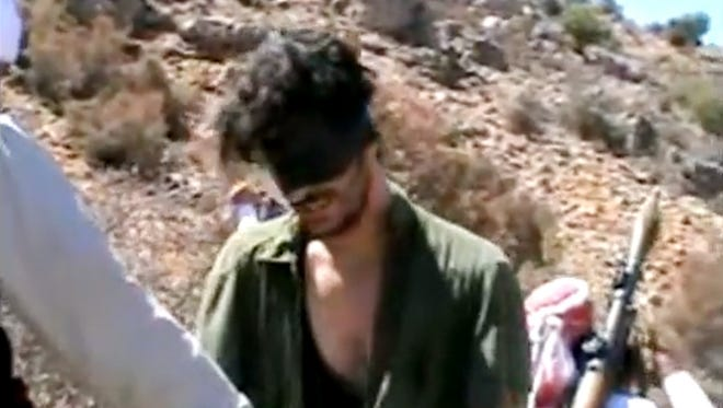In this image posted on YouTube, gunmen are seen holding U.S. freelance journalist Austin Tice, who has been missing in Syria since August. The AP could not independently confirm the origin or the content of the clip, but the Tice family confirmed in a statement that it is their son in the video.