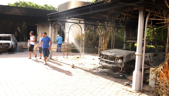 The day after the Sept. 11 attack, Libyans walked around the grounds of the gutted U.S. Consulate in Benghazi after an attack that killed four Americans, including Ambassador Chris Stevens.