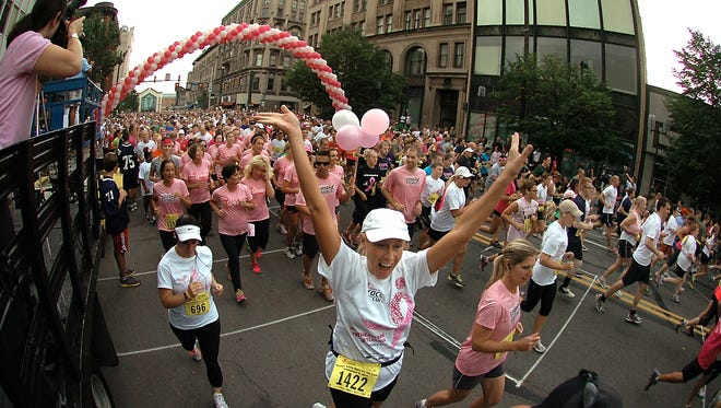 A sea of runners and walkers create a traffic jam during the start of the 22nd annual Susan G. Komen Northeast Pennsylvania Race for the Cure held on Sept. 8 in Scranton, Pa.