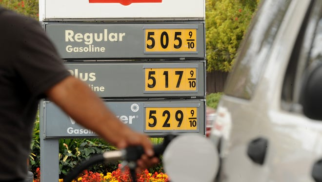 A motorist pumps gasoline at a Menlo Park, Calif., Shell station as gasoline prices soared to record levels.