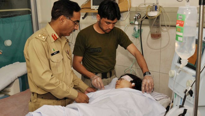 Pakistani army doctors treat Malala Yousafzai, 14, an activist for the education of girls, who was shot by a gunman while boarding her school bus in Mingora, Pakistan.
