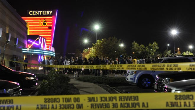 People gather outside the Century 16 movie theater in Aurora, Colo., at the scene of a mass shooting  July 20.