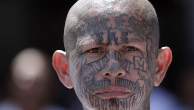 An inmate belonging to the Mara Salvatrucha or MS-13 gang stands inside the prison in Ciudad Barrios, El Salvador, last year.  The Obama administration Oct. 11 labeled the gang a transnational criminal organization.