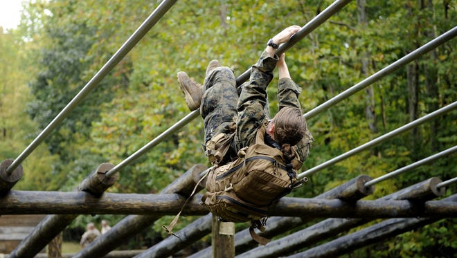 On Sept. 28, one of two female second lieutenants negotiated an obstacle during the combat endurance test, first event of the Marine Corps' 13-week Infantry Officers Course. One of the two officers failed to complete the endurance test that day and dropped out. The other was dropped Friday for unspecified medical reasons. More women are expected to volunteer for future infantry training.