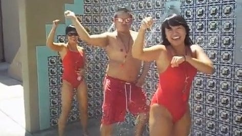 The El Monte (Calif.) City Council voted to rehire 14 lifeguards fired for making a 'Gangnam Style' spoof video, which has received more than 2 million views on YouTube. Three of the lifeguards appear in this screen grab of the video.