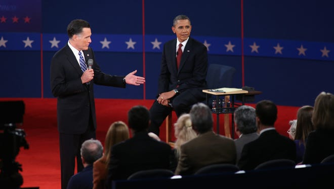 Mitt Romney and President Obama meet during a town hall-style debate at Hofstra University.