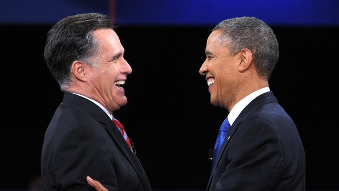 Mitt Romney and President Obama share a laugh at their final debate.